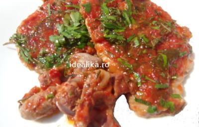 Friptura de porc cu sos de rosii